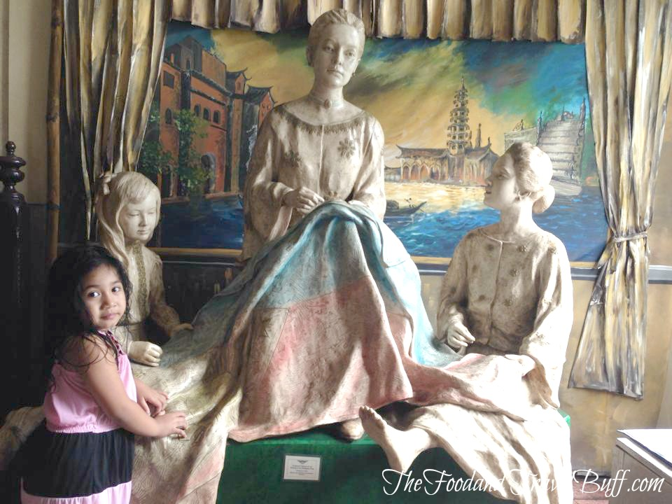 Marcela Agoncillo's famous statue of weaving the Philippine flag.